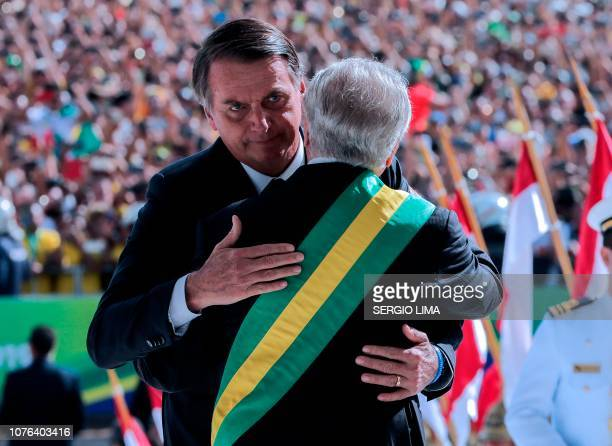 Brazil's new president Jair Bolsonaro is welcomed by outgoing Brazilian president Michel Temer upon arriving at the Planalto presidential palace in...