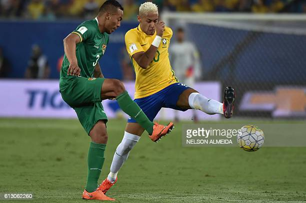 Brazil's Neymar and Bolivia's Edemir Rodriguez vie for the ball during their Russia 2018 World Cup qualifier football match in Natal Brazil on...