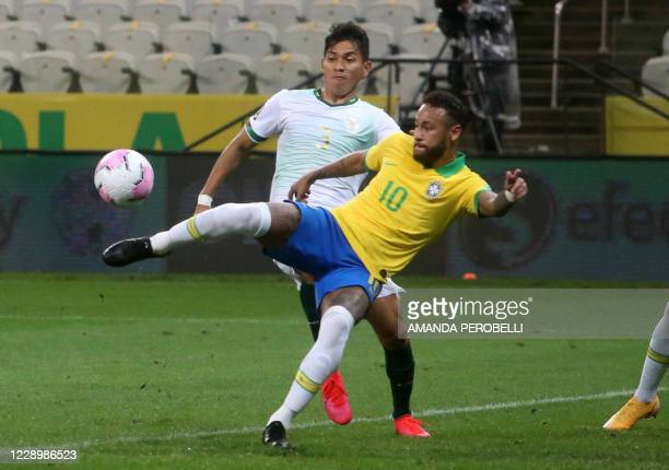 Brazil's Neymar and Bolivia's Jesus Sagredo vie for the ball during their 2022 FIFA World Cup South American qualifier football match at the Neo...