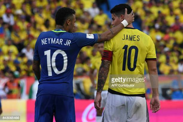 TOPSHOT Brazil's Neymar and Colombia's James Rodriguez talk during their 2018 World Cup qualifier football match in Barranquilla Colombia on...