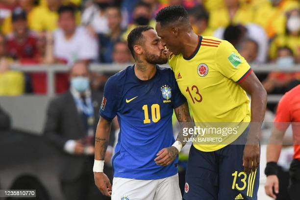Brazil's Neymar and Colombia's Yerry Mina are seen during their South American qualification football match for the FIFA World Cup Qatar 2022 at the...