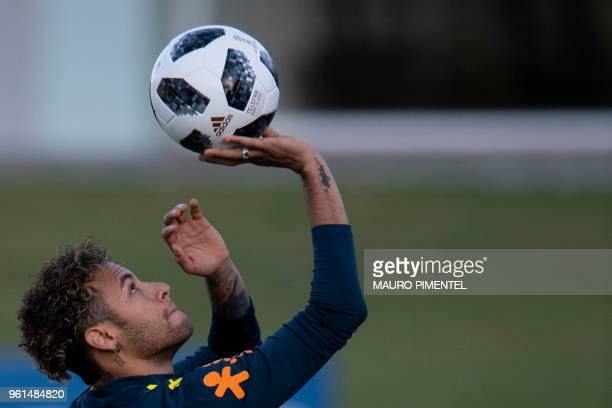 TOPSHOT Brazil's Neymar attends a training session of the national football team ahead of FIFA's 2018 World Cup at Granja Comary training centre in...