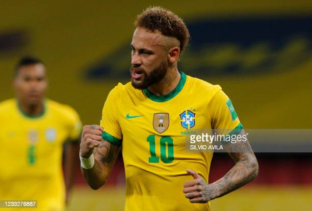 Brazil's Neymar celebrates after scoring a penalty against Ecuador during their South American qualification football match for the FIFA World Cup...
