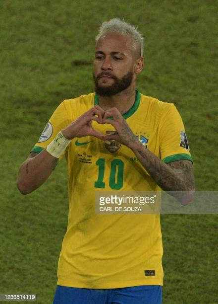 Brazil's Neymar celebrates after scoring against Peru during the Conmebol Copa America 2021 football tournament group phase match at the Nilton...