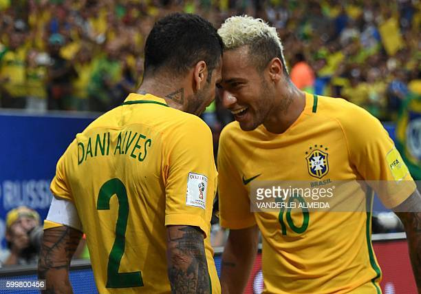 TOPSHOT Brazil's Neymar celebrates with Brazil's Dani Alves after scoring against Colombia during their Russia 2018 FIFA World Cup football qualifier...