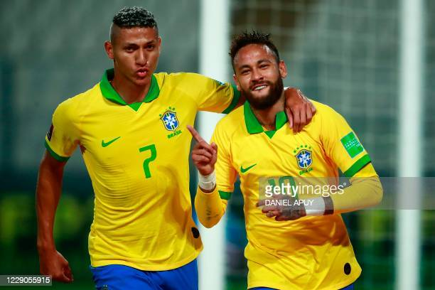 Brazil's Neymar celebrates with teammate Richarlison after scoring a penalty against Peru during their 2022 FIFA World Cup South American qualifier...