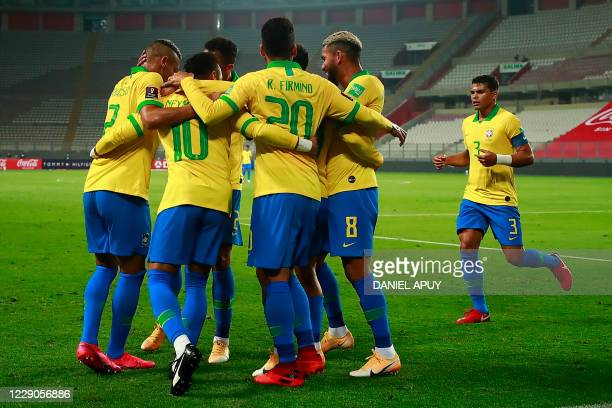 Brazil's Neymar celebrates with teammates after scoring against Peru during their 2022 FIFA World Cup South American qualifier football match at the...