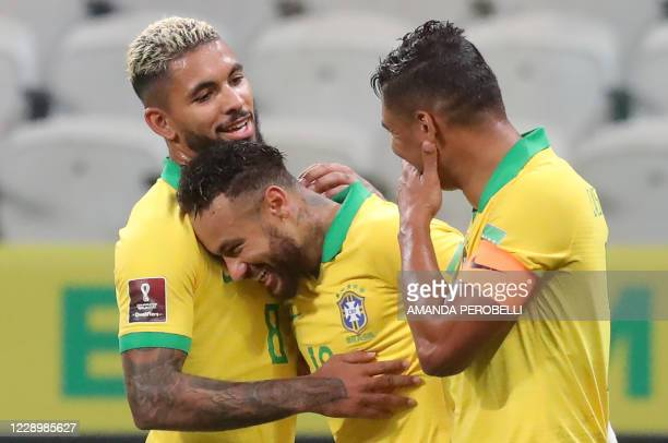 Brazil's Neymar celebrates with teammates Douglas Luiz and Thiago Silva a goal scored by Philippe Coutinho , during the 2022 FIFA World Cup South...