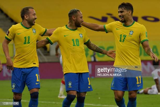 Brazil's Neymar celebrates with teammates Everton Ribeiro and Lucas Paqueta after scoring against Peru during the South American qualification...