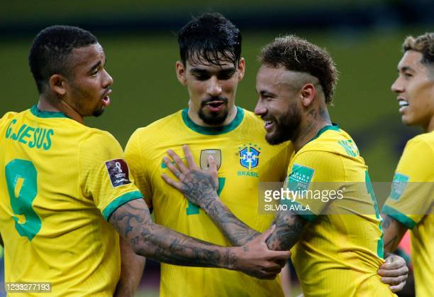 Brazil's Neymar celebrates with teammates Gabriel Jesus and Lucas Paqueta after scoring a penalty against Ecuador during their South American...