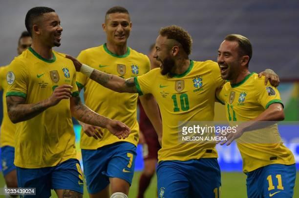 Brazil's Neymar celebrates with teammates Gabriel Jesus, Richarlison and Everton Ribeiro after scoring against Venezuela during the Conmebol Copa...