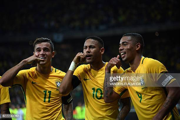 TOPSHOT Brazil's Neymar celebrates with teammates Philippe Coutinho and Gabriel Jesus after scoring against Argentina during their 2018 FIFA World...