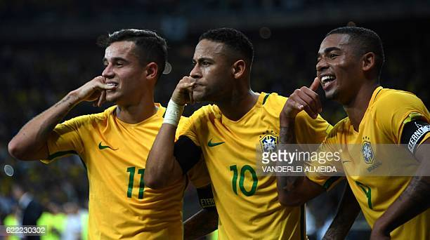 Brazil's Neymar celebrates with teammates Philippe Coutinho and Gabriel Jesus after scoring against Argentina during their 2018 FIFA World Cup...