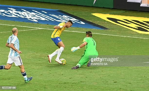 Brazil's Neymar challenges Argentina's goalkeeper Sergio Romero during 2018 FIFA World Cup qualifier football match in Belo Horizonte Brazil on...
