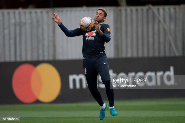 Brazil's Neymar controls the ball during a training session of the national football team at the Granja Comary sports complex in Teresopolis about 90...