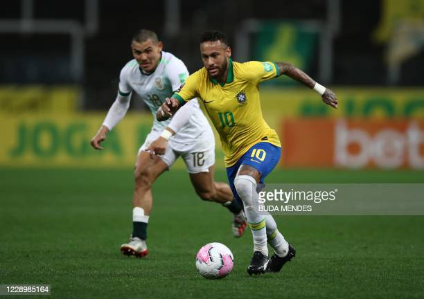 Brazil's Neymar drives the ball during the 2022 FIFA World Cup South American qualifier football match against Bolivia at the Neo Quimica Arena, also...