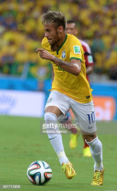 Brazil's Neymar in action during the 2014 FIFA World Cup Brazil Quarter Final match between Brazil and Colombia at Castelao on July 4 2014 in...