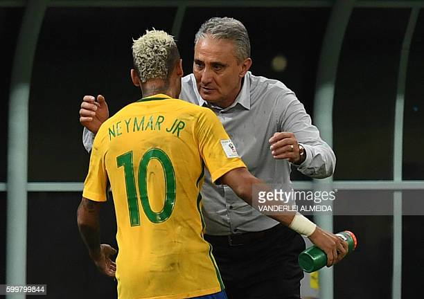 Brazil's Neymar Jr celebrates with coach Tite after scoring against Colombia during their Russia 2018 FIFA World Cup football qualifier match Brazil...