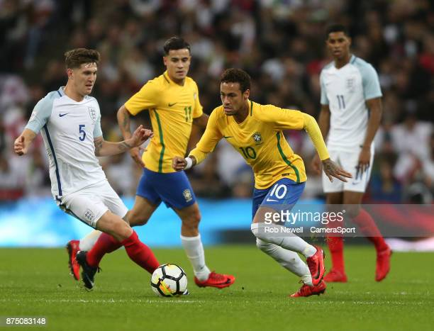 Brazil's Neymar JR gets past England's John Stones during the Bobby Moore Fund International between England and Brazil at Wembley Stadium on...
