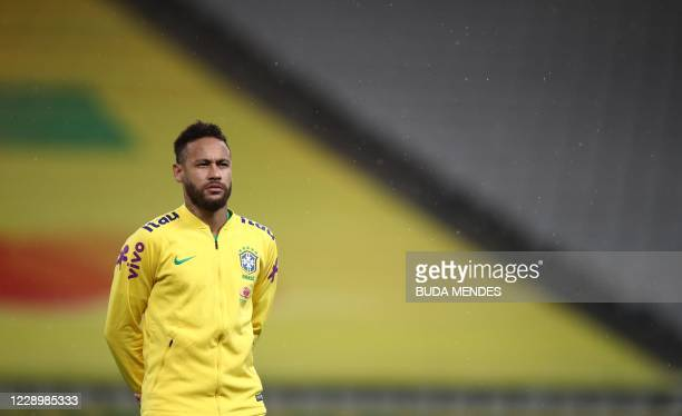 Brazil's Neymar listens to the national anthem during the 2022 FIFA World Cup South American qualifier football match against Bolivia at the Neo...