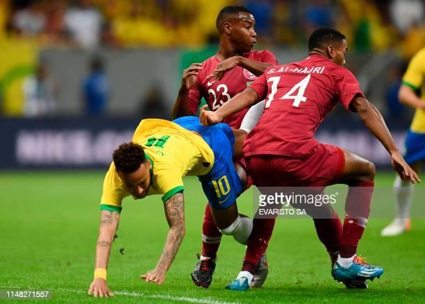 TOPSHOT Brazil's Neymar Qatar's Assim Madebo and Qatar's Salem Alhajri vie for the ball during a friendly football match at the Mane Garrincha...