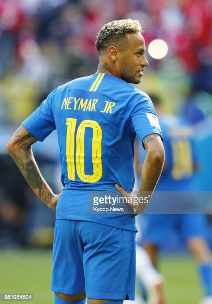 Brazil's Neymar reacts to the decision through Video Assistant Referee to overturn a penalty awarded to the country during the second half of a World...