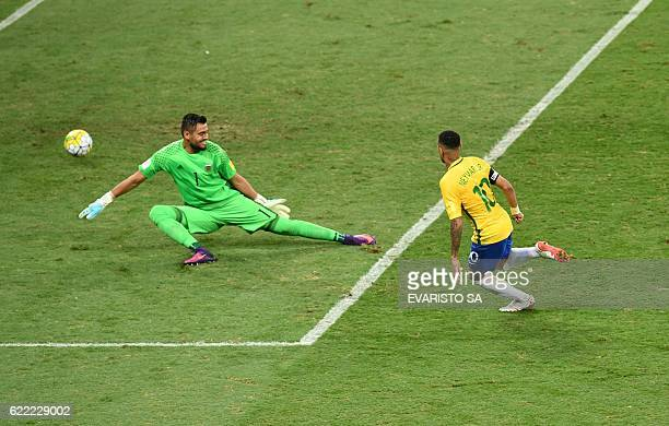 Brazil's Neymar scores past Argentina's goalkeeper Sergio Romero during their 2018 FIFA World Cup qualifier football match in Belo Horizonte Brazil...