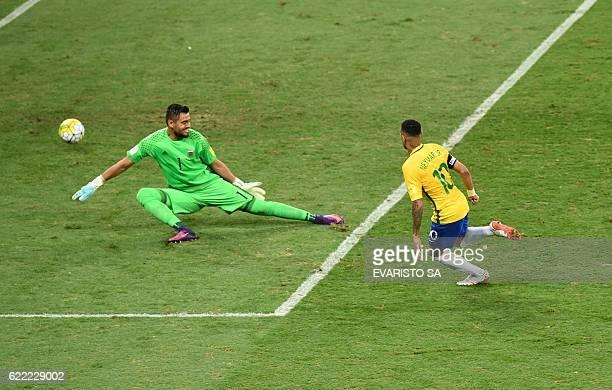 Brazil's Neymar scores past Argentina's goalkeeper Sergio Romero during their 2018 FIFA World Cup qualifier football match in Belo Horizonte Brazil...