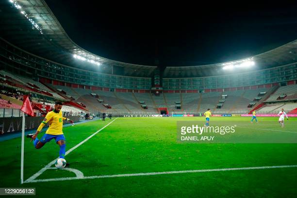 Brazil's Neymar takes a corner-kick during the 2022 FIFA World Cup South American qualifier football match against Peru at the National Stadium in...