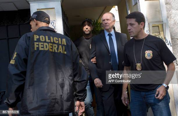 Brazil's Olympic Committee chief Carlos Nuzman is escorted from his home by federal police in Rio de Janeiro on October 5 2017 Brazilian police on...