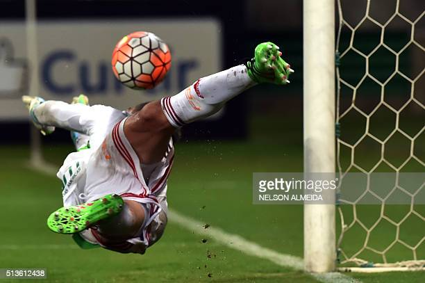 TOPSHOT Brazil's Palmeiras goalkeeper Fernando Prass dives to clear a penalty shot during their 2016 Copa Libertadores football match against...