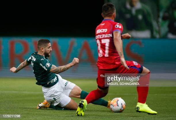 Brazil's Palmeiras midfielder Ze Rafael kicks to score against Argentina's Tigre during their closed-door Copa Libertadores group phase football...