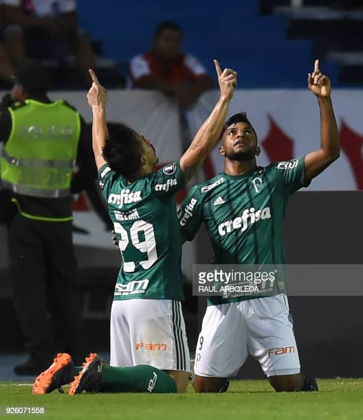Brazil's Palmeiras player Miguel Borja celebrates with a teammate his goal against Colombias Atletico Junior during their Copa Libertadores football...