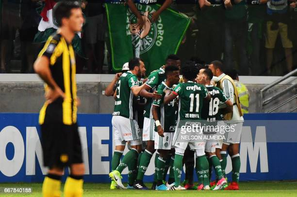 Brazil's Palmeiras players celebrate a goal scored by Dudu against Uruguay's Penarol during their 2017 Copa Libertadores football match held at...