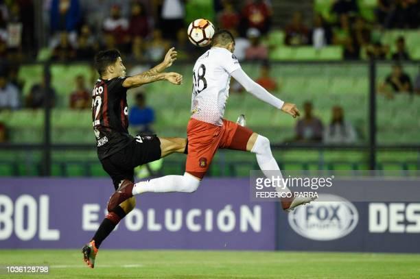 Brazil's Paranaense Marcio de Sousa Junior vies for the ball with Venezuela's Caracas Rubert Quijada during their Copa Sudamericana 2018 football...