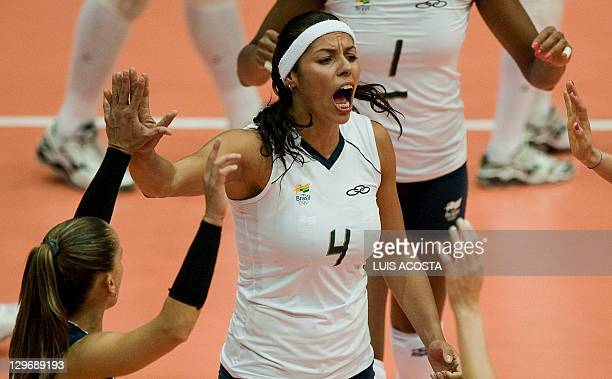 Brazil's Paula Pequeno celebrates winning a set against Domican Republic during their semifinal volleyball match at the Pan American Volleyball...