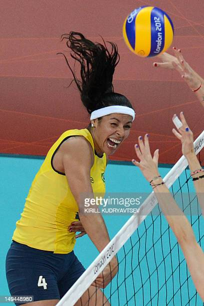 Brazil's Paula Pequeno spikes during the women's volleyball match between Turkey and Brazil in the 2012 London Olympic Games in London on July 28...