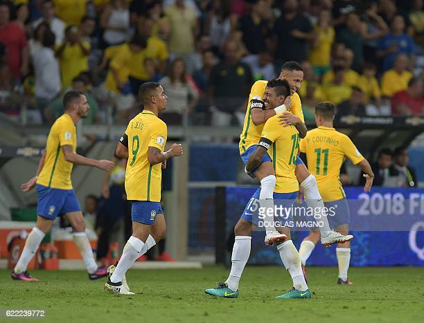 Brazil's Paulinho celebrates with Neymar after scoring against Argentina during their 2018 FIFA World Cup qualifier football match in Belo Horizonte...