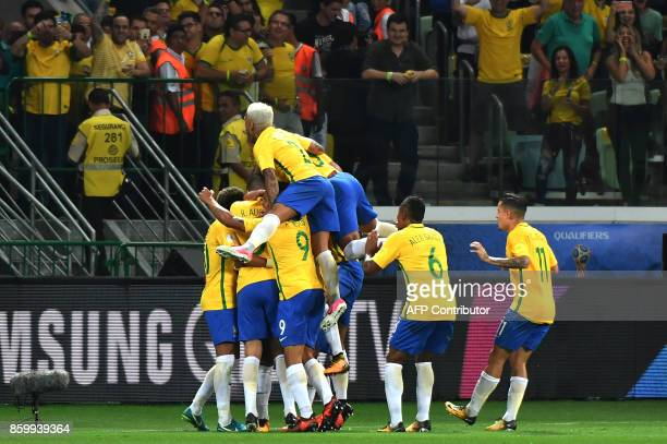 Brazil's Paulinho celebrates with teammates after scoring against Chile during their 2018 World Cup football qualifier match in Sao Paulo Brazil on...