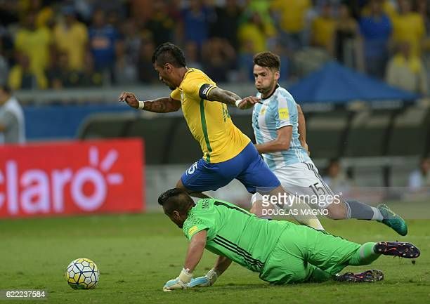 Brazil's Paulinho drives the ball past Argentina's goalkeeper Sergio Romero during the 2018 FIFA World Cup qualifier football match in Belo Horizonte...