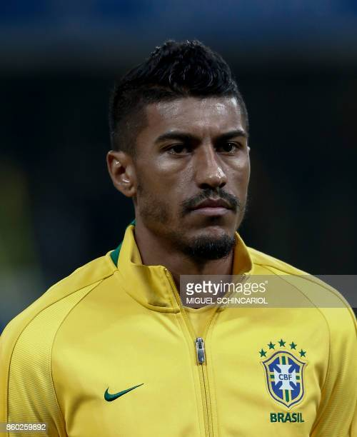 Brazil's Paulinho poses before the FIFA 2018 World Cup qualifier football match against Chile in Sao Paulo Brazil on October 10 2017 / AFP PHOTO /...