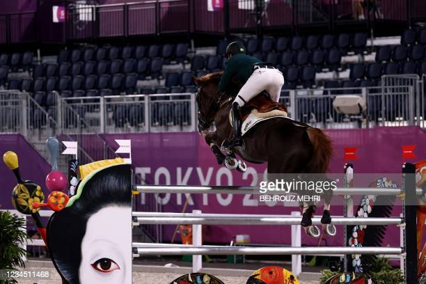 Brazil's Pedro Veniss riding Quabri de l'Isle competes in the equestrian's jumping team qualifying during the Tokyo 2020 Olympic Games at the...