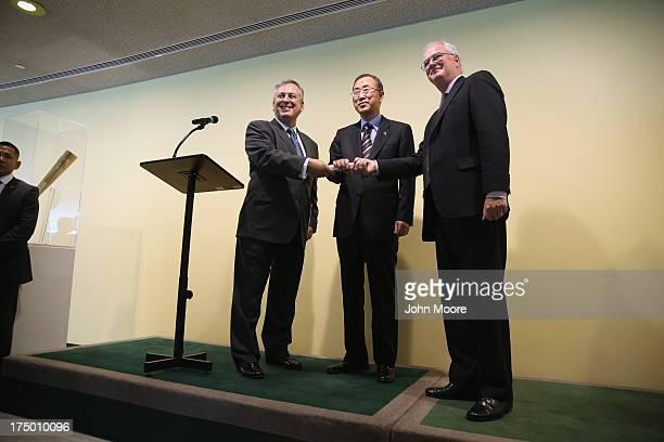 Brazil's permanent UN representative Luiz Alberto Figueiredo Machado receives a symbolic Olympic baton from Sir Mark Lyall Grant permanent...