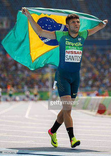 Brazil's Petrucio Ferreira dos Santos takes the Gold Medal in the Men's 100m T47 Final in the Olympic Stadium during the Paralympic Games in Rio de...