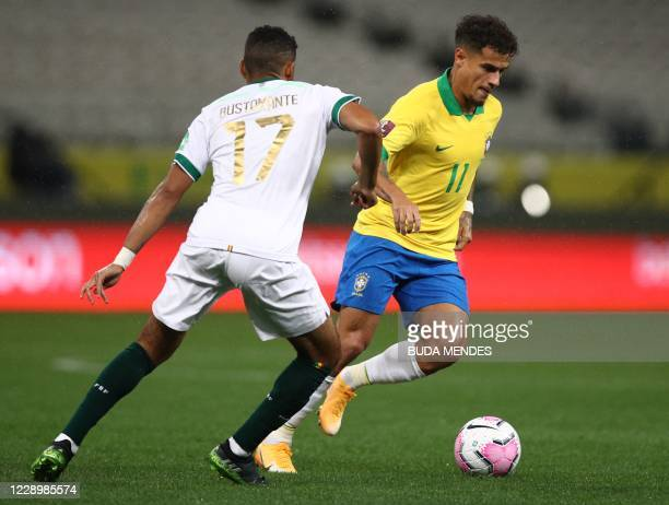 Brazil's Philippe Coutinho and Bolivia's Antonio Bustamante vie for the ball during their 2022 FIFA World Cup South American qualifier football match...