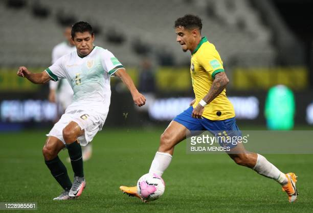 Brazil's Philippe Coutinho and Bolivia's Diego Wayar vie for the ball during their 2022 FIFA World Cup South American qualifier football match at the...