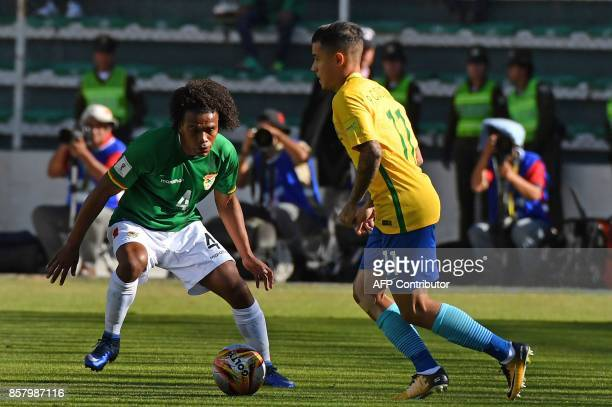 Brazil's Philippe Coutinho and Bolivia's Leonel Morales vie for the ball during their 2018 World Cup qualifier football match in La Paz on October 5...