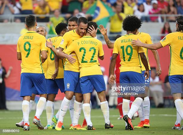 Brazil's Philippe Coutinho celebrates scoring his team's second goal during the Copa America Centenario tournament football match in Orlando Florida...