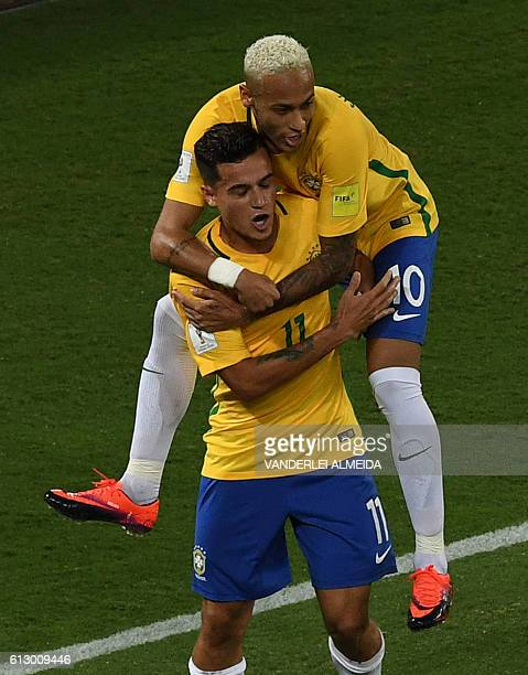 Brazil's Philippe Coutinho celebrates with Neymar after scoring against Bolivia during their Russia 2018 World Cup football qualifier match in Natal...