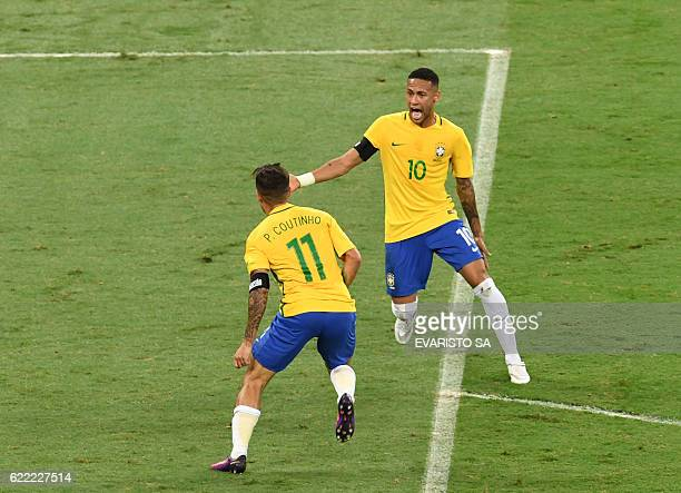 Brazil's Philippe Coutinho celebrates with teammate Neymar after scoring against Argentina during their 2018 FIFA World Cup qualifier football match...
